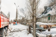 Fire in an industrial warehouse on Lantenskaya Street, rubber is burning, lots of smoke and flames royalty free stock photo