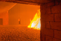 Fire inside the coal boiler grate Stock Photography