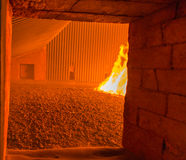 Fire inside the coal boiler grate Stock Images