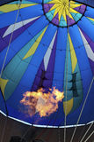 Fire Inside. Flames inside a hot air balloon as it fills up in preparation for take off royalty free stock image
