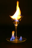 Fire inside glass. Fire inside medium martini glass Royalty Free Stock Photography