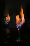 Fire inside glass and reflection. Fire inside medium martini glass and reflection Stock Photo