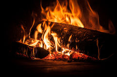 Fire inside pizza oven Royalty Free Stock Images