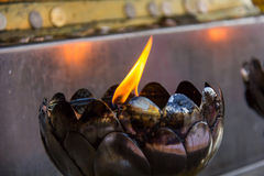 Fire in the iron lamp. In the background Stock Photo
