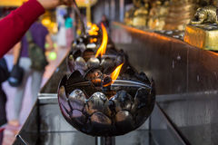 Fire in the iron lamp. In the background Royalty Free Stock Photos