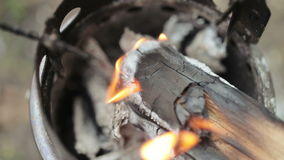 Fire in iron stove stock video