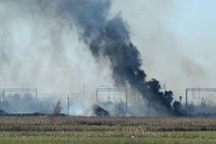 Fire on irrigation canals Stock Images