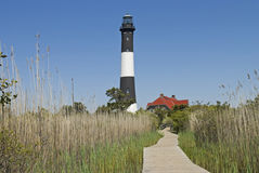Fire Island Lighthouse. The Fire Island Lighthouse as seen from the nature boardwalk in Fire Island National Seashore State Park in Long Island Royalty Free Stock Photo