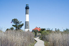 Fire Island Lighthouse. Wooden walkway leads to the Fire Island Lighthouse at Robert Moses State Park, Long Island, New York Stock Photography