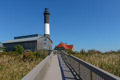 Fire Island Lighthouse. The Fire Island Lighthouse as seen from the nature boardwalk in Fire Island National Seashore State Park in Long Island stock images