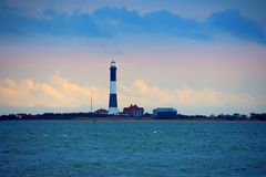 Fire Island Lighthouse with beaming light on Long Island Sound, New York royalty free stock photos