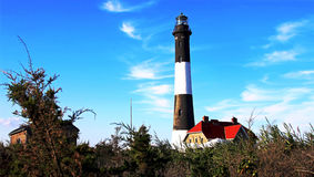 The Fire Island Lighthouse. With a deep blue sky royalty free stock photography