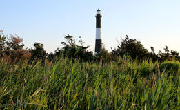 The Fire Island Lighthouse. Rises up from the green grass stock photos