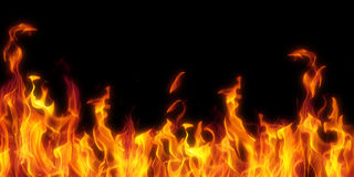Fire isolated over black Royalty Free Stock Images