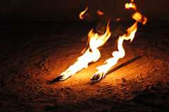 Fire juggle Stock Images