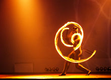 Fire juggler. A fire juggler act on stage - spiral fire trails Royalty Free Stock Photography