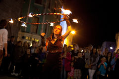 Fire juggler. GALWAY, IRELAND - JULY 5: Unidentified Fire juggler performs on streets of Galway  during Volvo Ocean Race 2011-12 Festival, on July 5, 2012 in Stock Photo