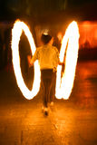 Fire juggler. Light trails during Venice carnival Royalty Free Stock Photos