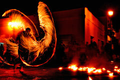 Fire juggler perfoms Royalty Free Stock Image
