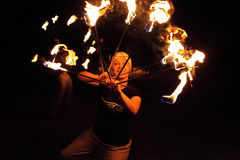 Fire juggler playing with fire Stock Photos