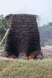 Fire in kiln for making mud bricks, Uganda, Africa Stock Photos