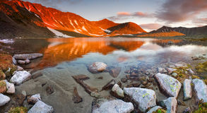 Fire Lake. Mountain lake ice age at the time of sunset in the mountains Royalty Free Stock Image