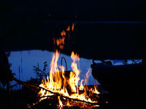 Fire on lake shore Royalty Free Stock Photo