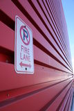 Fire Lane. A fire lane sign on a long red wall Royalty Free Stock Photography