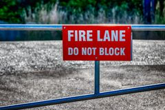 Fire lane do not block sign on a fence royalty free stock photos