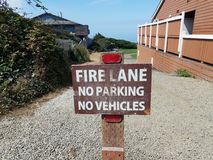 Fire lane no parking no vehicles sign and gravel royalty free stock images