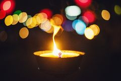 The fire from the lantern with the bokeh background. royalty free stock images