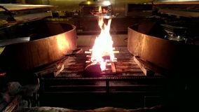 Fire in a large grill stock video footage