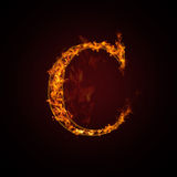 Fire letter. On dark background Royalty Free Stock Photo