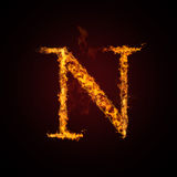 Fire letter. On dark background Stock Images