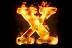 Fire letter X of burning flame light, 3D rendering. Isolated on black background Royalty Free Stock Photo
