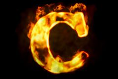 Fire letter C of burning flame light, 3D rendering. Isolated on black background Royalty Free Stock Image