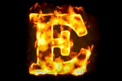 Fire letter E of burning flame light, 3D rendering. Isolated on black background Royalty Free Stock Photos