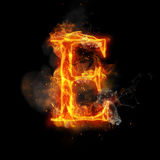 Fire letter E of burning flame light. Fire letter E of burning flame. Flaming burn font or bonfire alphabet text with sizzling smoke and fiery or blazing shining Stock Photos