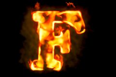 Fire letter F of burning flame light, 3D rendering. Isolated on black background Royalty Free Stock Photos