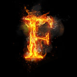 Fire letter F of burning flame light. Fire letter F of burning flame. Flaming burn font or bonfire alphabet text with sizzling smoke and fiery or blazing shining Stock Image