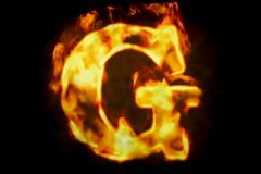 Fire letter G of burning flame light, 3D rendering. Isolated on black background Royalty Free Stock Photography