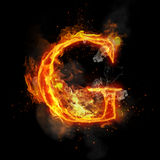 Fire letter G of burning flame light. Fire letter G of burning flame. Flaming burn font or bonfire alphabet text with sizzling smoke and fiery or blazing shining Royalty Free Stock Photo