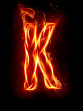 Fire letter K Stock Photo