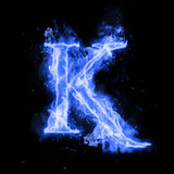 Fire letter K of burning flame light. Fire letter K of burning blue flame. Flaming burn font or bonfire alphabet text with sizzling smoke and fiery or blazing Royalty Free Stock Photos
