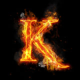 Fire letter K of burning flame light. Fire letter K of burning flame. Flaming burn font or bonfire alphabet text with sizzling smoke and fiery or blazing shining Royalty Free Stock Images