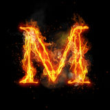 Fire letter M of burning flame light. Fire letter M of burning flame. Flaming burn font or bonfire alphabet text with sizzling smoke and fiery or blazing shining Stock Photo