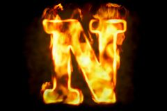 Fire letter N of burning flame light, 3D rendering. Isolated on black background Stock Image