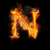 Fire letter N of burning flame light. Fire letter N of burning flame. Flaming burn font or bonfire alphabet text with sizzling smoke and fiery or blazing shining Stock Images