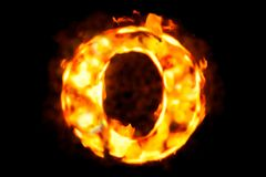 Fire letter O of burning flame light, 3D rendering. On black background Royalty Free Stock Photography