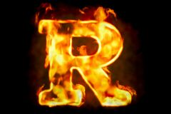 Fire letter R of burning flame light, 3D rendering. Isolated on black background Stock Photo